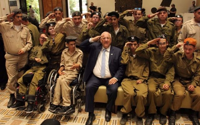President Reuven Rivlin saluting the 20 IDF soldiers from the Special in Uniform program who were awarded certificates for excellent service on Tuesday, June 6 (Courtesy Hana Azriel)