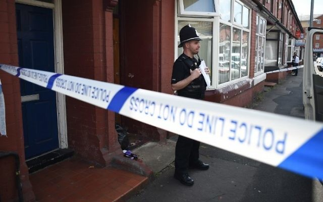 Illustrative: A Police officer stands on duty outside a residential property on Banff Road in Rusholme, Manchester, northern England on May 31, 2017, as police investigations continue into the May 22 terror attack at the Manchester Arena. (AFP PHOTO / Oli SCARFF)