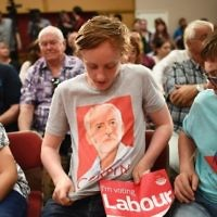 A young Labour Party supporter shows off his T-shirt with the face of Jeremy Corbyn, before an election campaign speech by the opposition leader in Basildon on June 1, 2017. (AFP/Justin Tallis)