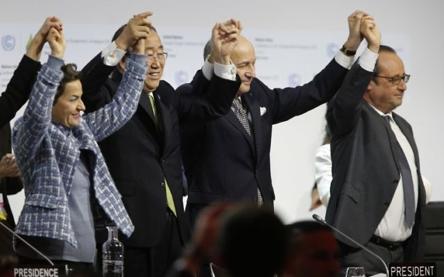 This file photo taken on December 12, 2015 shows then Foreign Affairs Minister and President-designate of COP21 Laurent Fabius (C), raises hands with then Secretary General of the United Nations Ban Ki Moon (2-L) and then France's President Francois Hollande (R) after adoption of a historic global warming pact at the COP21 Climate Conference in Le Bourget, north of Paris. (AFP PHOTO / FRANCOIS GUILLOT)