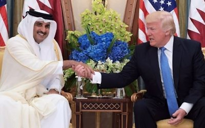 This file photo taken on May 21, 2017 shows US President Donald Trump (R) shaking hands with Qatar's Emir Sheikh Tamim Bin Hamad Al-Thani, during a bilateral meeting at a hotel in the Saudi capital Riyadh. (AFP Photo/Mandel Ngan)