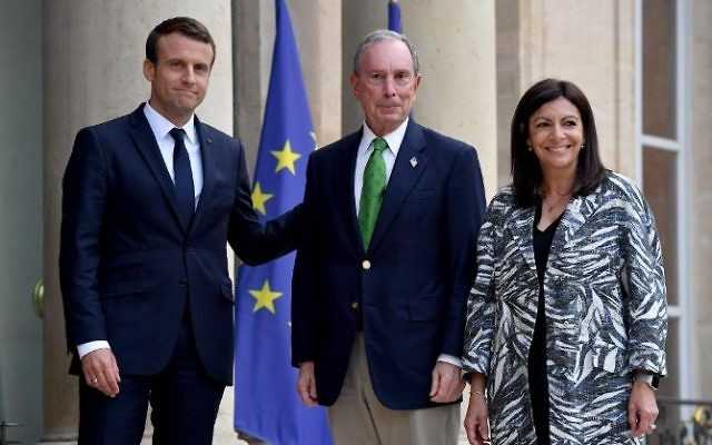 French President Emmanuel Macron, left, welcomes former mayor of New York City Michael Bloomberg flanked by  Paris mayor Anne Hidalgo, right,  prior their meeting at the Elysee Palace in Paris, on June 2, 2017. (AFP/Christophe Petit Tesson)