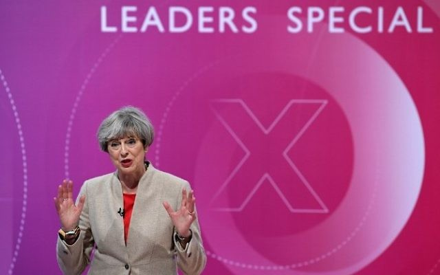 British Prime Minister Theresa May takes part in 'The Question Time, Leaders Special' hosted by David Dimbleby in York in northern England on June 2, 2017, ahead of the upcoming general election. (AFP/Stefan Rousseau)