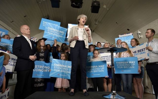 Britain's Prime Minister Theresa May speaks during an election campaign event at Thornhill Cricket and Bowling Club in Dewsbury, West Yorkshire, June 3, 2017. (AFP/POOL/HANNAH MCKAY)
