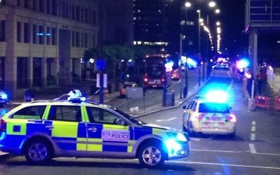Illustration: A photograph taken on a mobile phone shows British police cars blocking the entrance to London Bridge, in central London on June 3, 2017, following an attack on the bridge.  (AFP PHOTO / Daniel SORABJI)