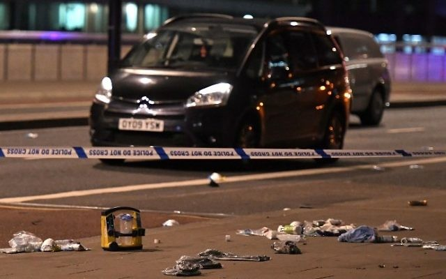 Debris and abandoned cars remain on London Bridge at the scene of a terror attack in central London on June 3, 2017. (AFP Photo/Chris J. Ratcliffe)