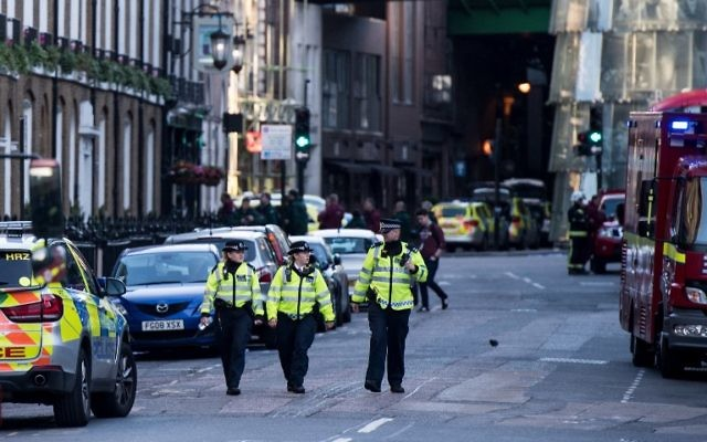 Police officers and emergency response vehicles are seen on the street outside Borough Market on June 04, 2017 the morning after a terror attack on London Bridge and the Borough area in London. (AFP Photo/Chris J Ratcliffe)
