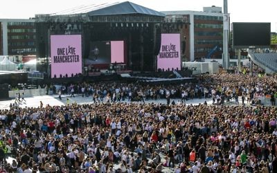 Music fans gather at the One Love Manchester benefit concert for the families of the victims of the May 22, Manchester terror attack, at Emirates Old Trafford in Greater Manchester on June 4, 2017. (AFP/Pool/Danny Lawson for One Love Manchester)
