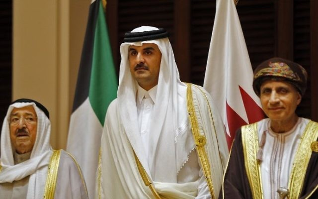 This file photo taken on December 7, 2016 shows Kuwaiti Emir Sabah al-Ahmad al-Jaber al-Sabah (L), Qatari Emir Sheikh Tamim bin Hamad al-Thani (C) and Oman's Foreign Minister Yusuf bin Alawi attending a Gulf Cooperation Council summit in the Bahraini capital Manama. (AFP Photo/Stringer)
