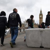 A concrete barrier between the road and the sidewalk is pictured after being installed on Westminster Bridge in London on June 5, 2017, in reaction to the recent terror attacks. (AFP Photo/Justin Tallis)