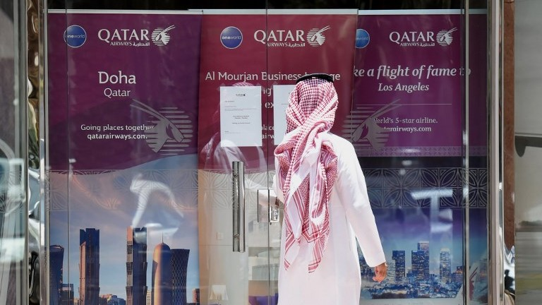 A picture taken on June 5, 2017, shows a man standing outside the Qatar Airways branch in the Saudi capital Riyadh. (AFP Photo/Fayez Nureldine)