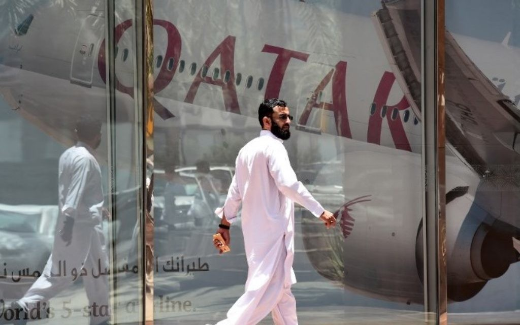 A man walking past the Qatar Airways branch in the Saudi capital Riyadh, after it had suspended all flights to Saudi Arabia following a severing of relations between major gulf states and gas-rich Qatar, June 5, 2017. (AFP/FAYEZ NURELDINE)