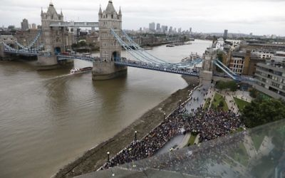 Tower Bridge is seen spanning the River Thames as people gather at Potters Fields Park for a vigil to commemorate the victims of the terror attack on London Bridge and at Borough Market, June 5, 2017. (AFP/Odd Andersen)