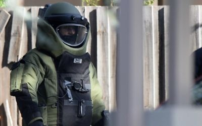 A special operations officer wears a bomb suit at the scene of a shootout in the Melbourne bayside suburb of Brighton on June 6, 2017. (Mal Fairclough / AFP)