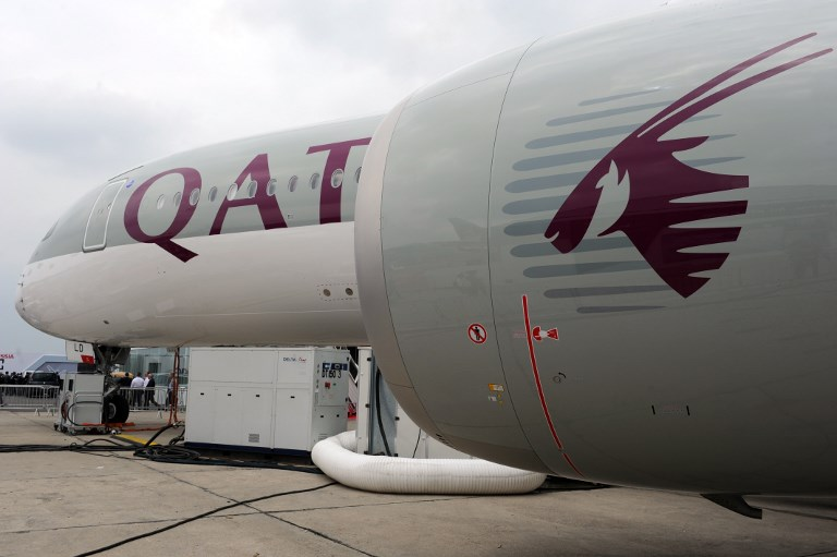 This photo taken on June 15, 2015 shows a Qatar Airways A350 900 on the tarmac during the International Paris Airshow at Le Bourget on June 15, 2015. (AFP PHOTO / ERIC PIERMONT)