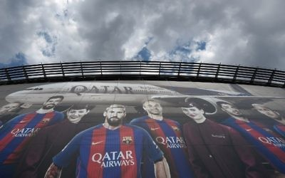 A Qatar Airways advertising billboard with pictures of Barcelona's players is pictured at Camp Nou stadium in Barcelona on June 6, 2017. (Luis Gene/AFP)