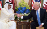 This file photo taken on May 21, 2017 shows US President Donald Trump, right, shaking hands with Qatar's Emir Sheikh Tamim Bin Hamad Al-Thani, during a bilateral meeting at a hotel in the Saudi capital Riyadh. (Mandel Ngan/AFP)