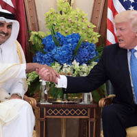 US President Donald Trump, right, shaking hands with Qatar's Emir Sheikh Tamim Bin Hamad Al-Thani, during a bilateral meeting at a hotel in the Saudi capital Riyadh, May 21, 2017. (Mandel Ngan/AFP)
