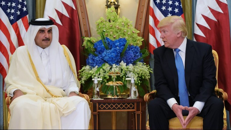 This file photo taken on May 21, 2017 shows US President Donald Trump (R) speaking with Qatar's Emir Sheikh Tamim Bin Hamad Al-Thani, during a bilateral meeting at a hotel in the Saudi capital Riyadh. (AFP Photo/Mandel Ngan)
