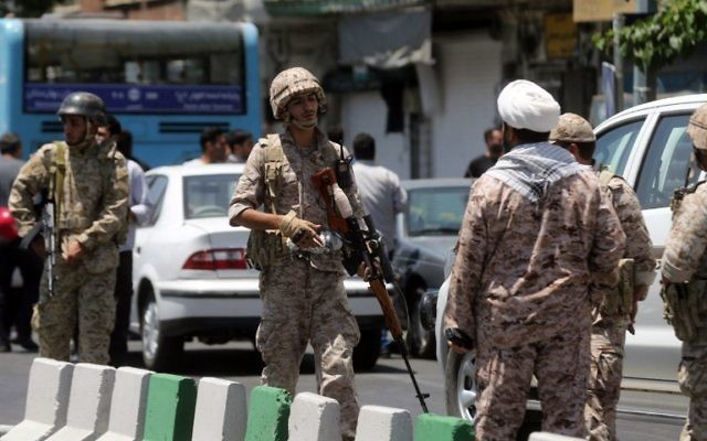 Members of the Iranian Revolutionary Guard secure the area outside the Iranian parliament during an attack on the complex in the capital Tehran on June 7, 2017. (AFP/Fars News/Hossein Mersadi)
