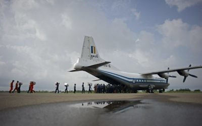 This photo taken on August 5, 2015 shows a Myanmar Air Force Shaanxi Y-8 transport aircraft being unloaded at Sittwe airport in Rakhine state, similar to the aircraft carrying over 100 people that went missing between the southern city of Myeik and Yangon on June 7, 2017. (AFP PHOTO / Ye Aung Thu)