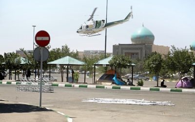 A picture taken on June 7, 2017, shows a police helicopter flying around outside the mausoleum of Ayatollah Ruhollah Khomeini in Tehran. (AFP PHOTO / MIZA NEWS / Hasan SHIRVANI)