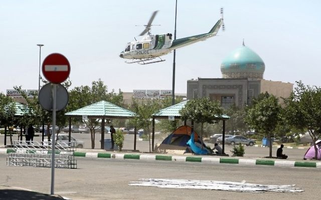 A police helicopter flying around outside the mausoleum of Ayatollah Ruhollah Khomeini in Tehran, Iran,  June 7, 2017. (AFP/MIZA NEWS/Hasan SHIRVANI)