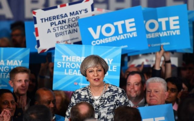 Britain's Prime Minister and leader of the Conservative Party Theresa May speaks during a general election campaign rally in Birmingham on June 7, 2017. (AFP PHOTO / BEN STANSALL)