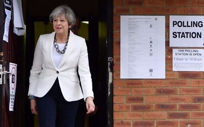 Britain's Prime Minister Theresa May leaves a polling station after casting her ballot paper in Sonning, west of London, on June 8, 2017, as Britain holds a general election.  (Ben Stansall/AFP)