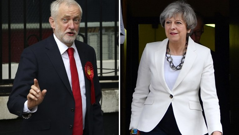 This combination picture shows opposition Labour party leader Jeremy Corbyn voting in north London and British Prime Minister Theresa May voting in Maidenhead on June 8, 2017, during Britain's general elections (Daniel Leal-Olivas/AFP)