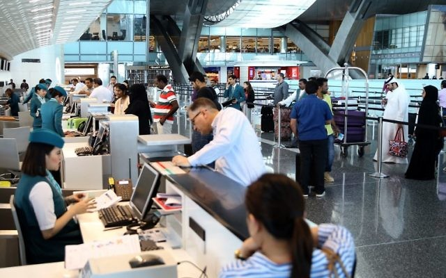 Passengers check-in at the Hamad International Airport in Doha on June 7, 2017. (AFP/STRINGER)