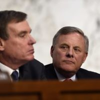 Committee Chairman Senator Richard Burr (R), along with Vice Chairman Senator Mark Warner (L), listens to testimony by former FBI Director James Comey during a hearing before the Senate Select Committee on Intelligence on Capitol Hill June 8, 2017 in Washington, DC. (AFP PHOTO / SAUL LOEB)