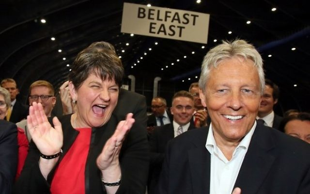Democratic Unionist Party (DUP) leader Arlene Foster, left, celebrates with Former Democratic Unionist Party (DUP) Leader, Peter Robinson (R) at the counting centre in Belfast, Northern Ireland, early in the morning of June 9, 2017, hours after the polls closed in Britain's general election. (AFP / Paul FAITH)