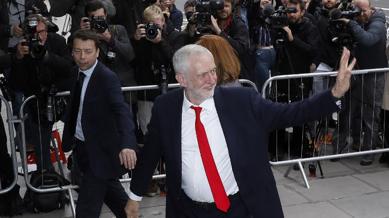 Britain's opposition Labour party Leader Jeremy Corbyn arrives at Labour Party headquarters in central London on June 9, 2017 after results in a snap general election showing a hung parliament with Labour gains and the Conservatives losing its majority. (Odd ANDERSEN / AFP)