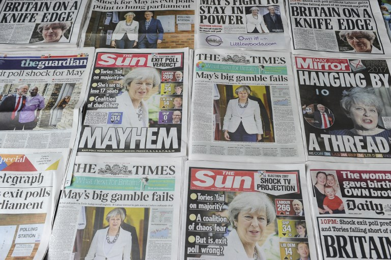 An arrangement of British daily newspapers are photographed as an illustration in London on June 9, 2017 showing front page stories about the exit poll results of the snap general election. (AFP PHOTO / DANIEL SORABJI)