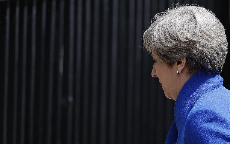 Britain's Prime Minister and leader of the Conservative Party Theresa May delivers a statement outside 10 Downing Street in central London on June 9, 2017 as results from a snap general election show the Conservatives have lost their majority. (AFP PHOTO / Adrian DENNIS)