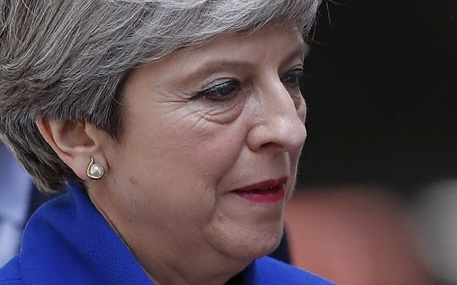 Britain's Prime Minister and leader of the Conservative Party Theresa May delivers a statement outside 10 Downing Street in central London on June 9, 2017 as results from a snap general election show the Conservatives have lost their majority. (AFP/Adrian Dennis)