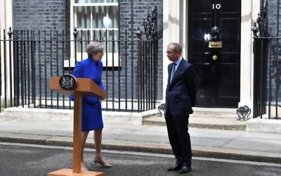 Britain's Prime Minister Theresa May, accompanied by her husband Philip, leaves after delivering a statement outside 10 Downing Street in central London on June 9, 2017 as results from a snap general election show the Conservatives have lost their majority. (AFP PHOTO / Ben STANSALL)