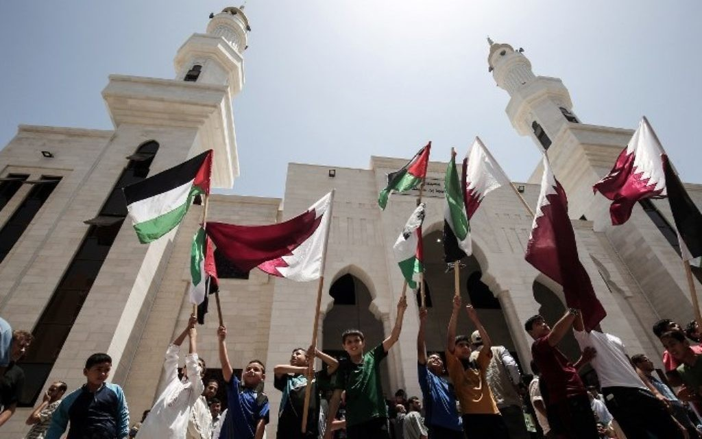 Palestinians rally in support of Qatar at a Qatari-funded housing project in the southern Gaza city of Khan Younis on June 9, 2017. (AFP Photo/Said Khatib)