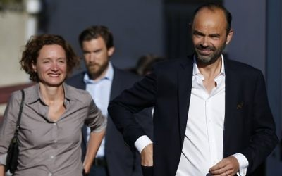 French Prime Minister Edouard Philippe flanked by his wife Edith Chabre (L) arrives at a polling station during the first round of legislative elections on June 11, 2017 in Le Havre, northern France. (Charly Triballeau/AFP)