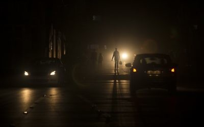 Palestinians walk on a dark street during a power outage in the al-Shati refugee camp in Gaza City, June 11, 2017. (AFP/Mahmud Hams)