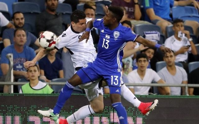 Albanian midfielder Odise Roshi, left, vies for the ball with Israel's Taleb Tawatha during the FIFA World Cup 2018 qualification football match between Israel and Albania in Haifa on June 11, 2017. (AFPThomas Coex)