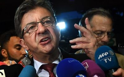 La France Insoumise (LFI) Leader Jean-Luc Melenchon (C) gestures as he addresses media representatives in Marseille on June 11, 2017, after polls closed for the first round of the French legislative elections. (AFP PHOTO / Anne-Christine POUJOULAT)