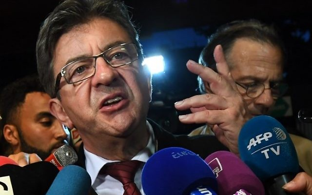 La France Insoumise (LFI) Leader Jean-Luc Melenchon (C) gestures as he addresses media representatives in Marseille on June 11, 2017, after polls closed for the first round of the French legislative elections. (AFP/Anne-Christine Poujoulat)