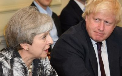 Britain's Prime Minister Theresa May, left, sits with Foreign Secretary Boris Johnson as she holds the first Cabinet meeting of her new team at 10 Downing Street in London on June 12, 2017, following the June 8 snap general election in which the ruling Conservatives lost their majority. (AFP Photo/Pool/Leon Neal)