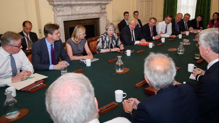 Britain's Prime Minister Theresa May (C) holds the first Cabinet meeting of her new team at 10 Downing Street in London on June 12, 2017, following the June 8 snap general election in which the ruling Conservatives lost their majority. (Leon Neal/Pool/AFP)