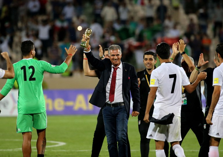 6633109f5 Portuguese coach Carlos Queiroz of the Iranian national football team  celebrates with players after winning the