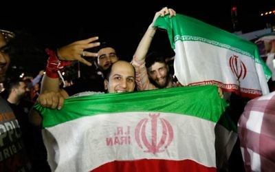 Iranians celebrate on the streets of Tehran early on June 13, 2017, after their national football team won the 2018 World Cup qualifying football match between Iran and Uzbekistan. (AFP PHOTO / STRINGER)