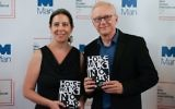 US translator Jessica Cohen (L) and Israeli author David Grossman (R) pose for a photograph with his book A Horse Walks Into a Bar at the shortlist photocall for the Man Booker International Prize at St James' Church in London on June 13, 2017. (AFP PHOTO / Daniel Leal-Olivas)