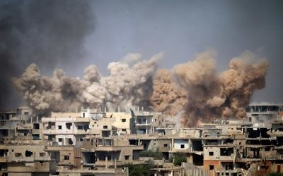 Smoke rises from buildings following a reported air strike on a rebel-held area in the southern Syrian city of Daraa, on June 14, 2017. (AFP/Mohamad Abazeed)
